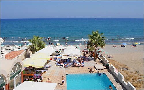 Swimming pool, sun terrace, beach and sea from above